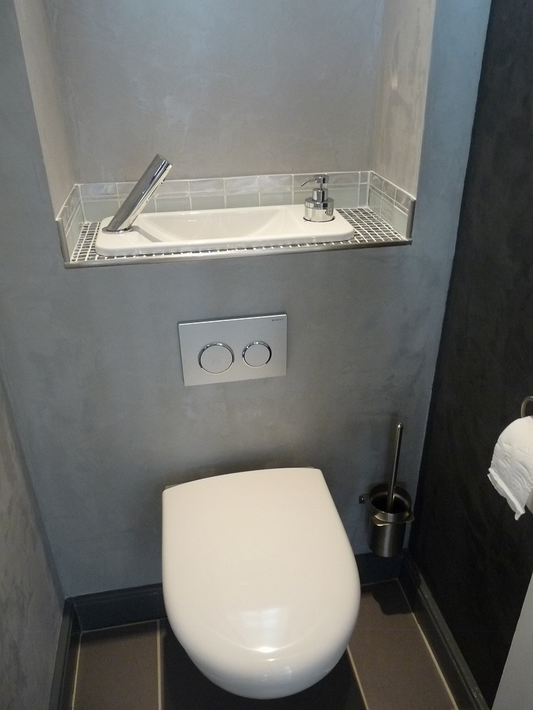 ... the space saving wall-mounted toilets with a compact hand wash basin